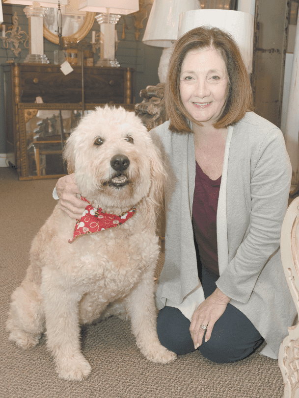 """One customer at the Village Firefly said, """"Addie Mae's love tank never gets full."""" The 10 ½-year-old goldendoodle loves when the store's customers love on her — and if they don't give her enough attention, she will lean on them until they notice her."""