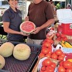 Andrea Snyder, left, of Urban Cookhouse with Randy Melvin of Southern Oaks Farm at the Crestline Farmers Market. (Journal photo by Maury Wald)