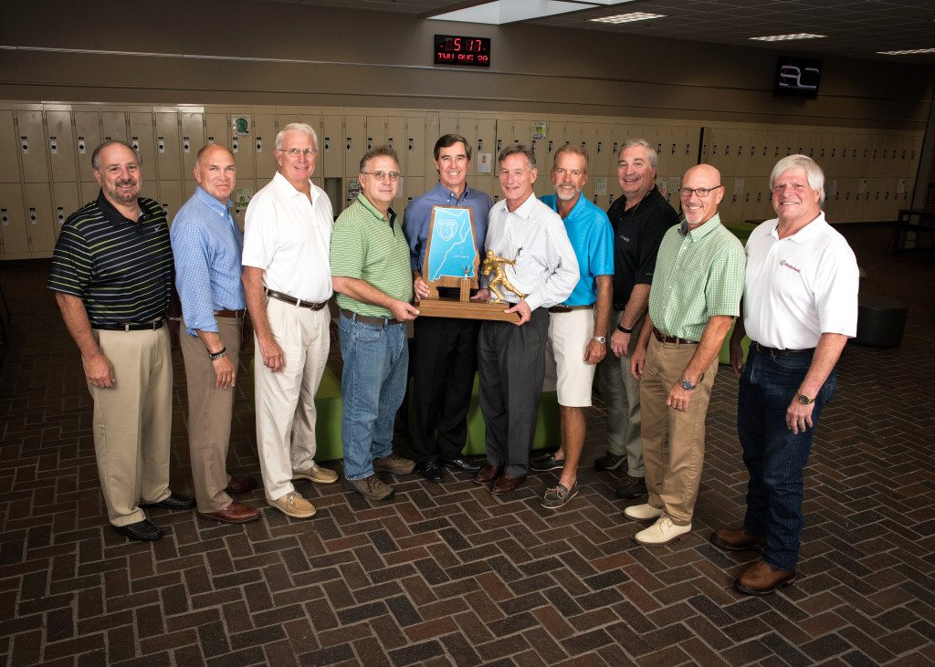 Former players and coaches from the 1975 Mountain Brook state 4A championship team still gather from time to time. Pictured are, from left: Don Smith, Bill Kreis, Coach Robert Higginbotham, Robbie Thomas, Scot Cardwell, Richard Burg, Greg McCormick, Dan Roberts, Dan Tourtellotte and Mat Whatley. Journal photo by Lee Walls Jr.