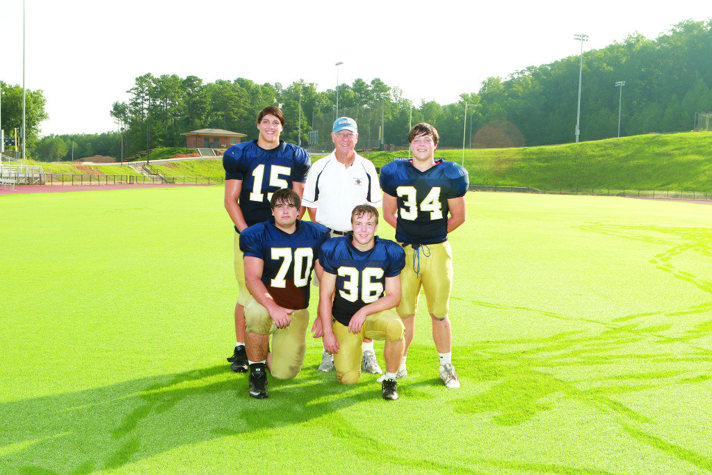 Briarwood coach Fred Yancey with key players, from left: Carter Bankston, Ross Thompson, Luther Ward and Jonathan McGehee.