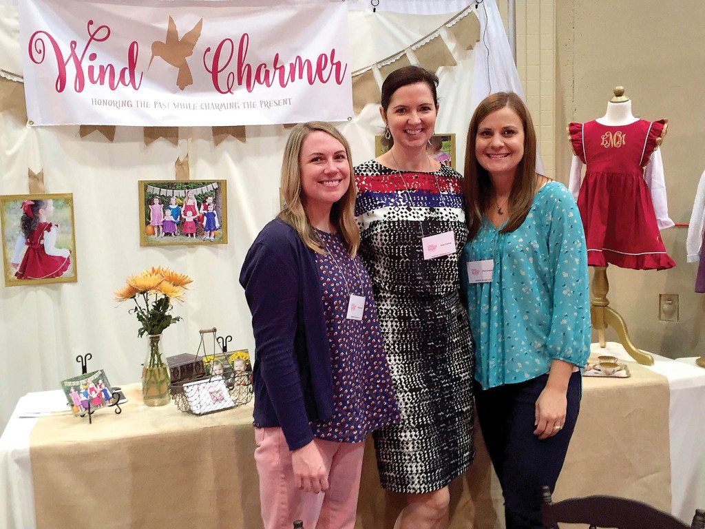 Sisters-in-law Mary Beth, Sandi and Jamie Meeks recently debuted their first line of Wind Charmer clothing at the Southern Women's Show Sept. 29-Oct. 1. Inspired by their daughters, the company is dedicated to creating vintage-inspired dresses for young girls. Photo special to the Journal