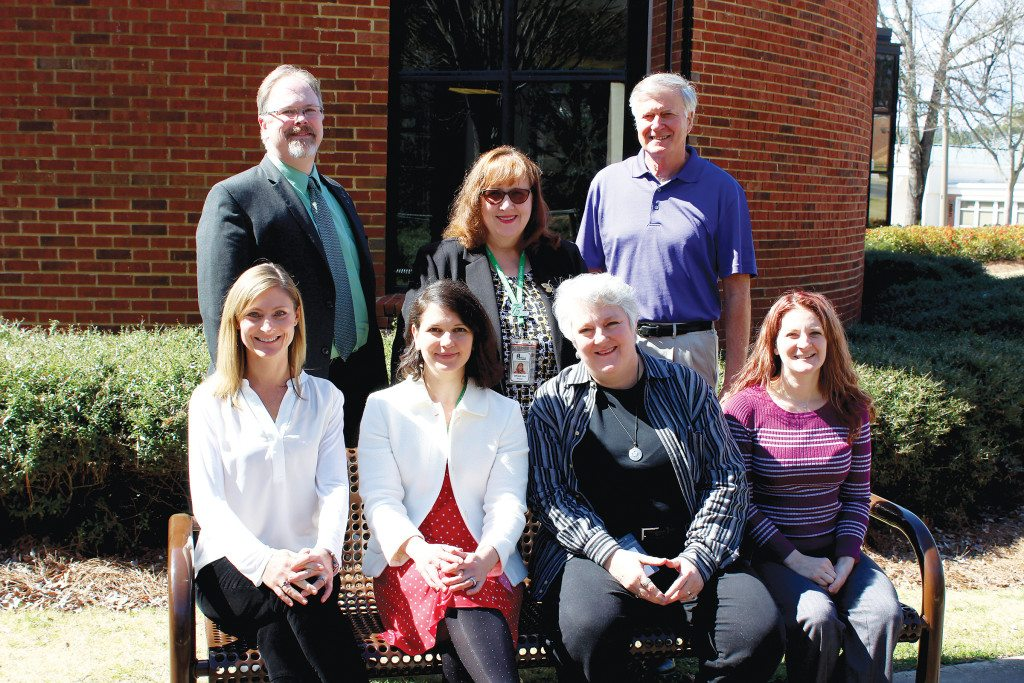 Board members and programming directors from Homewood Public Library preparing for the library's 75th anniversary March 24, include: Standing, Board Chairman Mike Higginbotham, Executive Director Deborah Fout and Vice-chairman Dr. Paul Doran. Front: Karen Roberson, Leslie West, Laura Tucker and Heather Cover. Journal photo by Emily Williams.