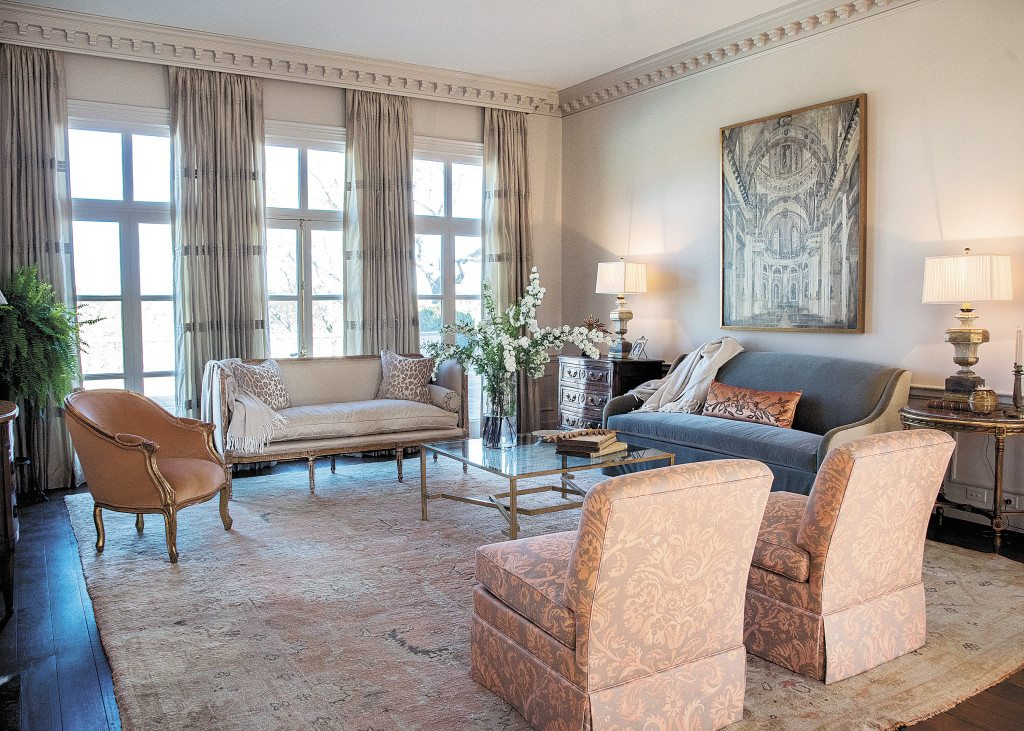 Libby Greene's ShowHouse living room has elegant conversation spots, including a sofa and Louis XVI settee. The Meredith Keith painting over the sofa is of the interior of the St.-Paul-St.-Louis cathedral in Paris.