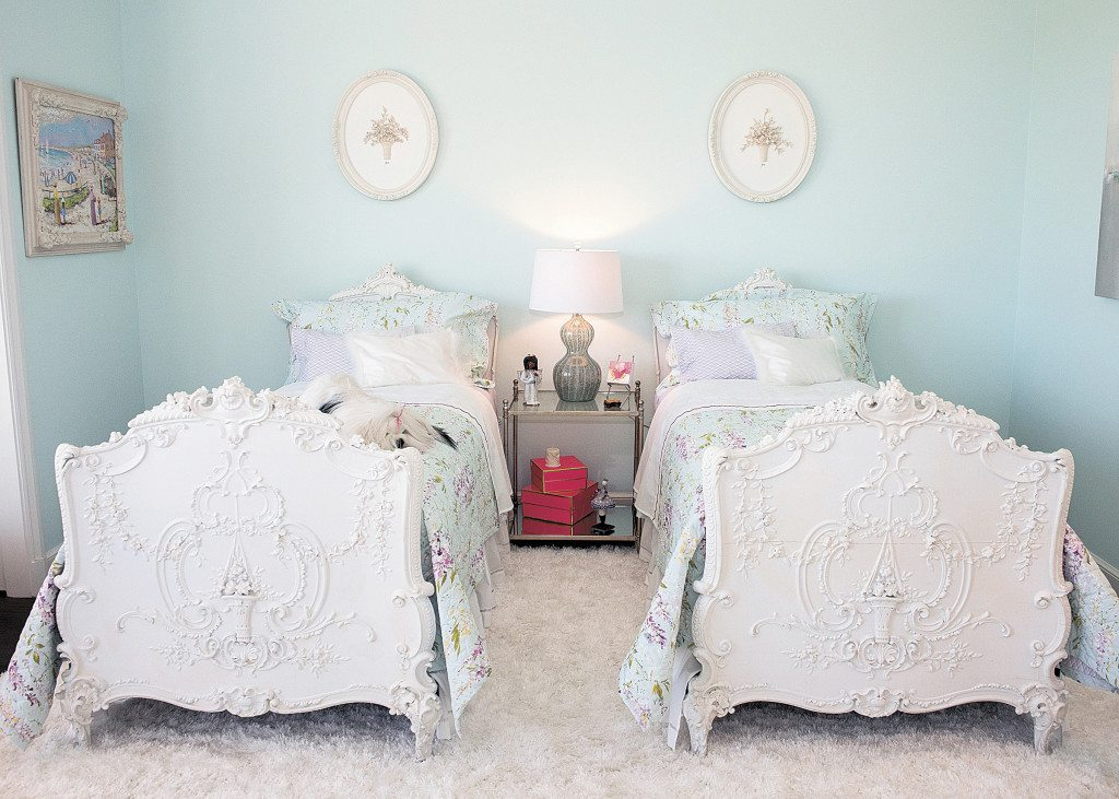 Jean Clayton of Christine's on Canterbury uses twin beds, of French origin but found in Canada, have gesso floral basket designs on their footboards in the upstairs bedroom of this year's Decorators' ShowHouse.