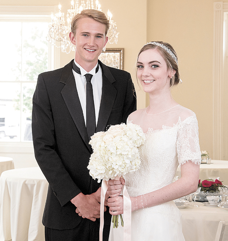 "Kate Edmonds and James McCool grew up as neighbors in Mountain Brook. The ""bride"" is wearing a Heidi Elnora gown, and the ""groom"" has on his grandfather's vintage Pierre Cardin tuxedo."