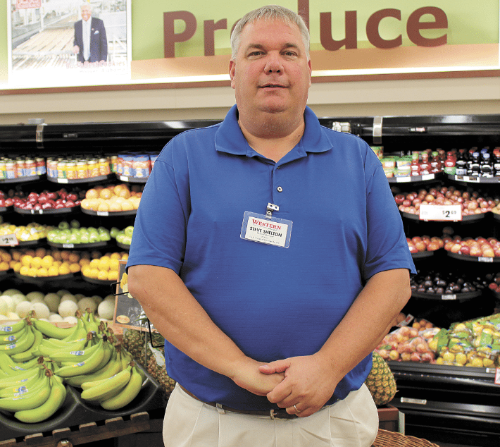 Steve Shelton, general manager of Western Supermarket on Rocky Ridge, has a long-standing partnership with the Exceptional Education Department at Vestavia Hills High School, providing a place for students with special needs to gain experience in the work force. Journal photo by Emily Williams.