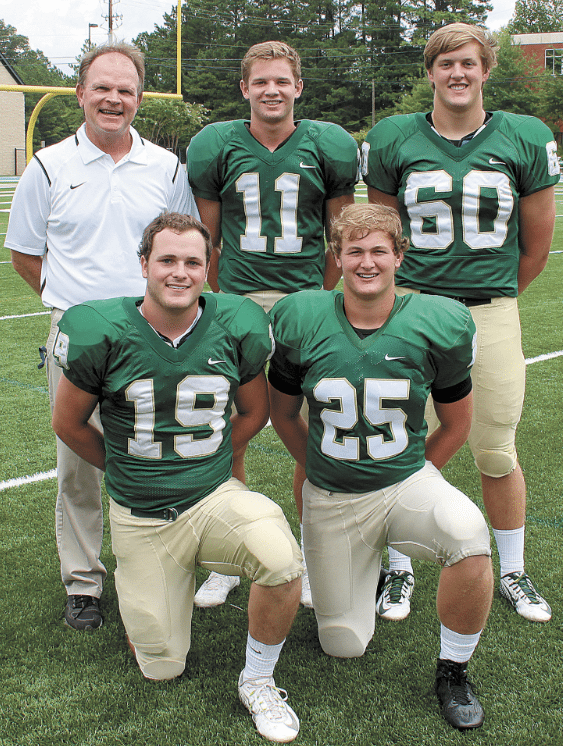 Coach Chris Yeager with, front, from left: Sam Everette and Will Wetzler. Back: Zach Carroll and Price Delk.