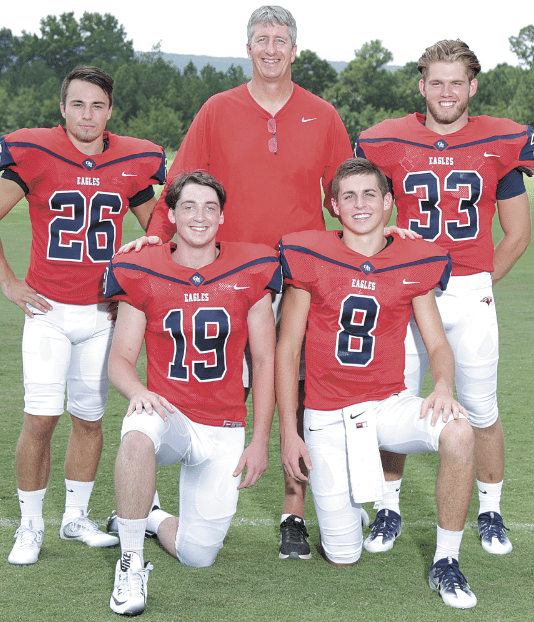 Coach Cris Bell with, from left, Daniel Salchert, Daniel Perkins, Wyatt Legas and Spencer Hughes.