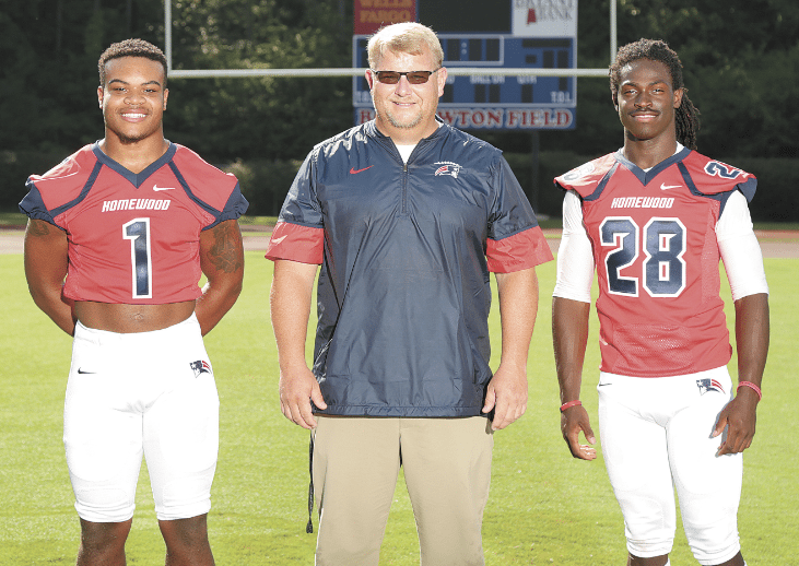 Coach Ben Berguson with, from left, Chestin Jones and Antarius Mitchell.