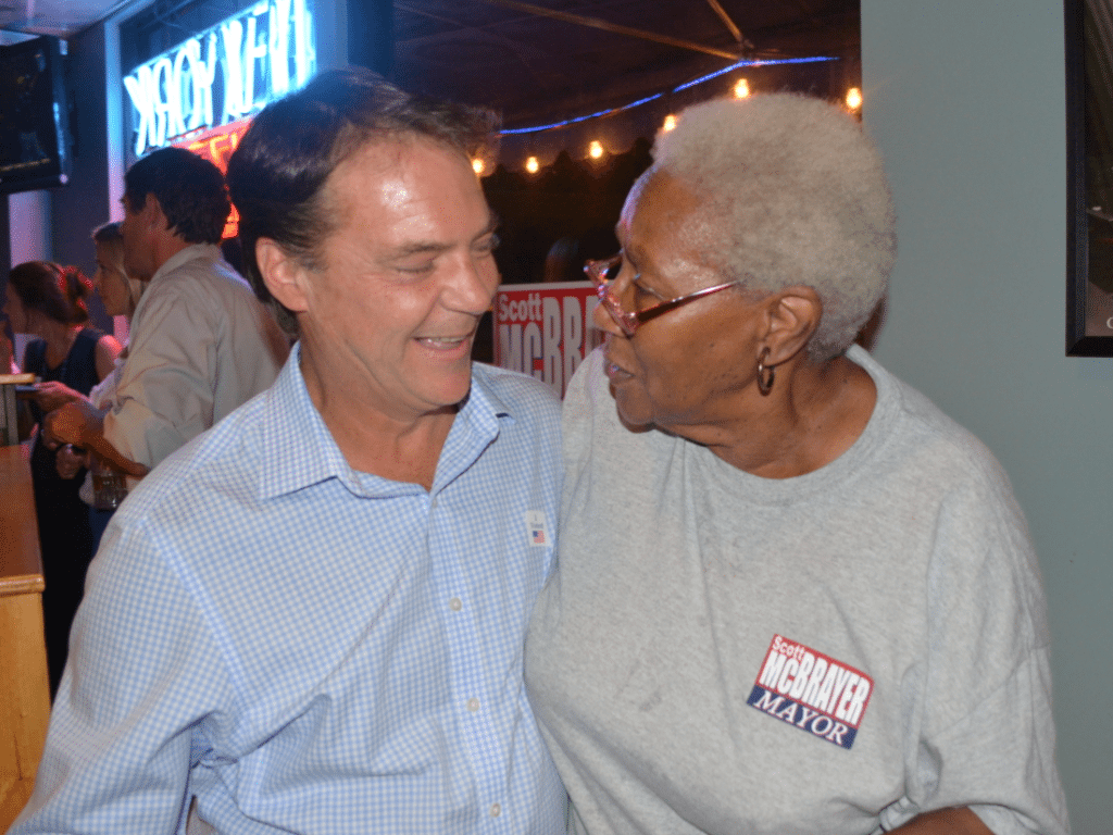Homewood Mayor Scott McBrayer celebrates with a supporter after winning his third term as mayor. Journal photo by William C. Singleton III.