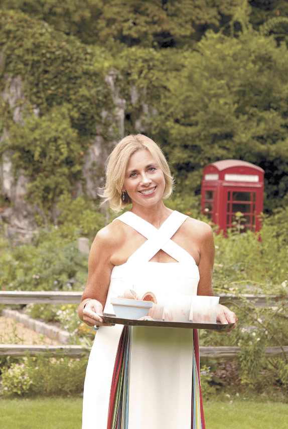 Leslie Register loves entertaining indoors and outdoors at her Mountain Brook home. She once gave British phone booth ornaments as party favors to remind guests of the actual one in her beautiful garden. Photo by Virginia Cravens Houston.