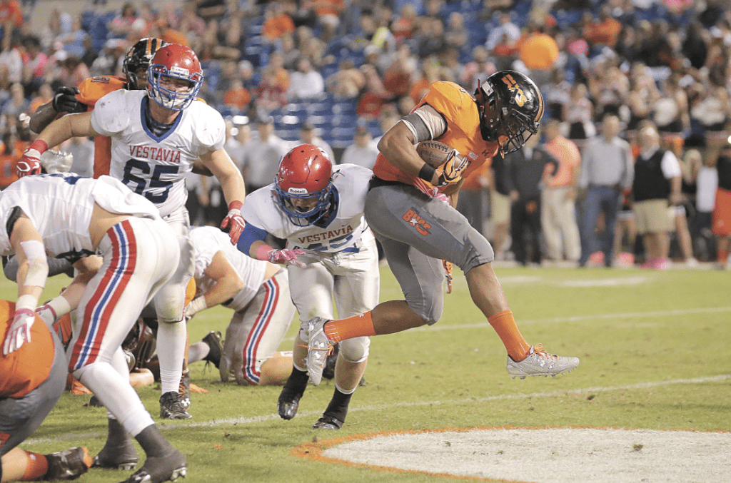 Hoover senior runningback C.J. Sturdivant breaks free from the pack. Journal photos by Marvin Gentry.