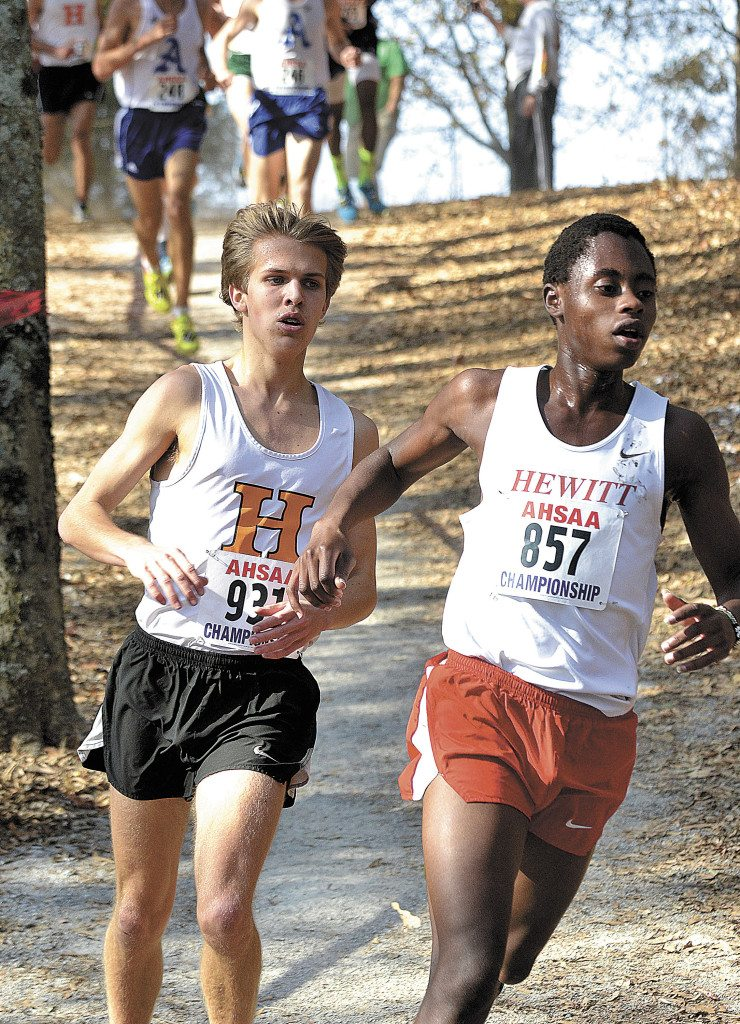 Hoover's Tommy McDonough (931) and Hewitt-Trussville's John Ngaruiya (857) compete in the boys' Class 7A race n the Alabama High School Athletic Association's 2016 State Cross Country Championships in Oakville, Ala. Saturday. (Photo by Todd Thompson/RiverCat Photography)