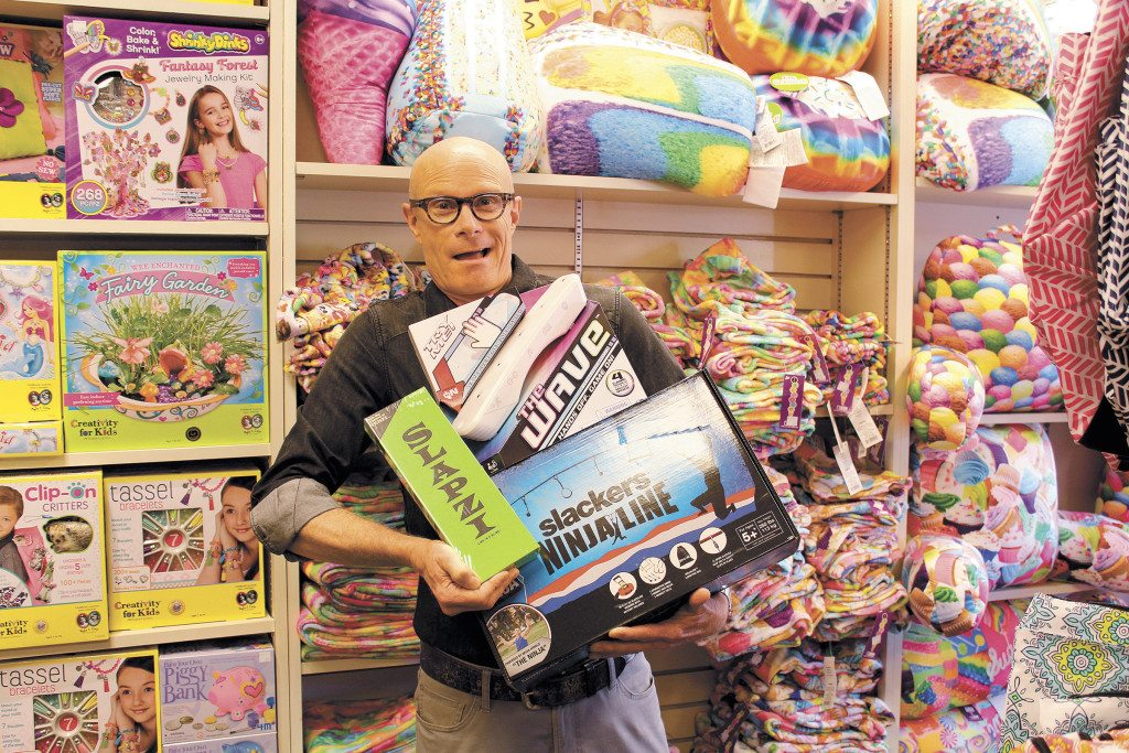 George Jones owner of Snoozy's Kids in Crestline Village with a few of his favorite toys. Journal photo by Emily Williams