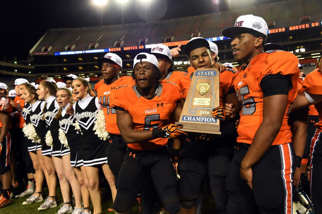 Hoover players celebrate after defeating McGill-Toolen in the AHSAA Super 7 Class 7A championship. Journal photos by Mark Almond.