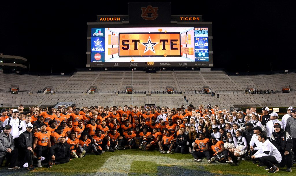 Hoover players pose after defeating McGill-Toolen.