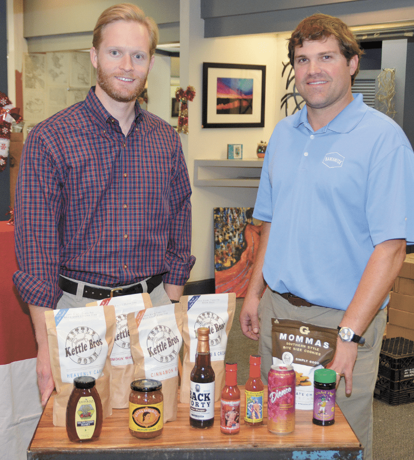 Bamawise partners Bobby LeMoine, left, and Jeff Gentry help Alabama food vendors get their products into the retail market. Journal photo by Jordan Wald.