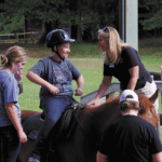 A Taste of Freedom: Director of Equestrian Program Uses Horses to Help Disabled Riders