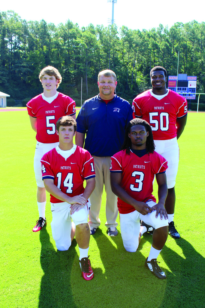 Homewood coach Ben Berguson with key players, from left: Alec Marsch, Carson Griffis, Derek Underwood and Griffin Gentry. Journal photo by Emily Williams