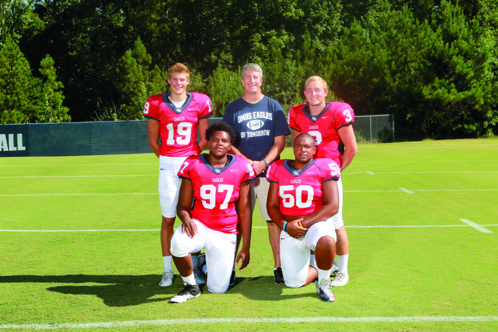 With Oak Mountain coach Cris Bell are key players, from left: Payton Youngblood, Armond Lloyd, Justice Hammond and Warren Shader.