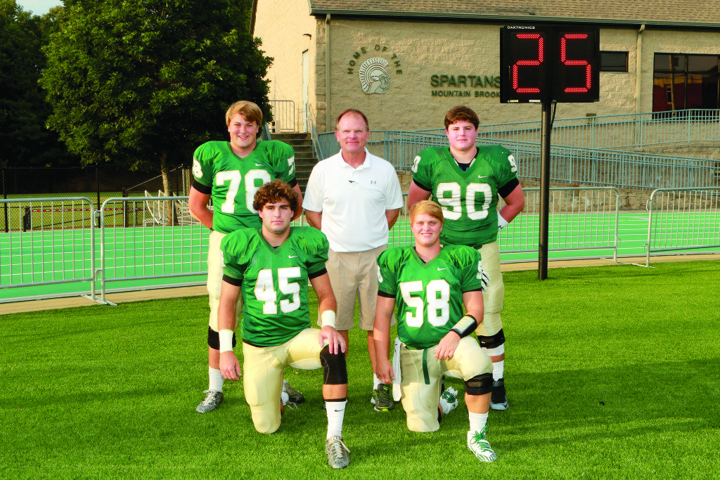 Mountain Brook coach Chris Yeager with key players, from left: Lawton Sparks, Joe McDonald, Rix Curtis and McKinnon Cox. Journal photo by Marvin Gentry