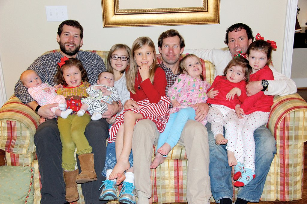 From left brothers Tanner, Forrest and Josh Meeks along with their wives are parents to eight daughters: Tinsley, Darby, Stella, Mary Katherine, Emily, Allie, Kendall and Leah. Photo special to the Journal
