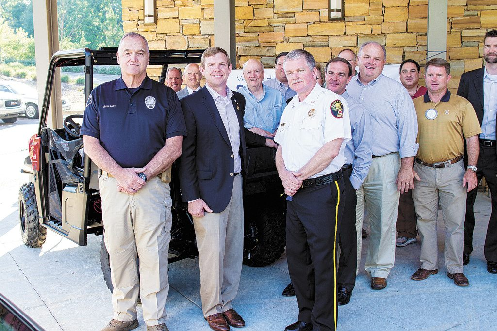 From left: Dan Rary, Vestavia Hills chief of police; Troy Hendrixson, Vestavia Sunrise Rotary Club president; Jim St. John, Vestavia Hills fire chief; and members of the Rotary are looking forward to this year's First Responders Celebration. Photo special to the Journal.