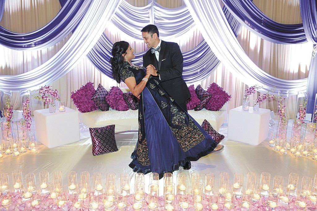 Milind dips his new bride at the formal reception the day after the ceremony.