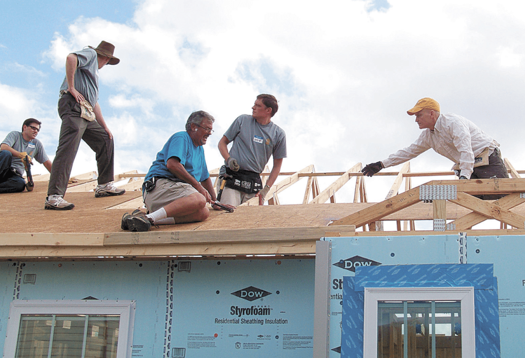 Steve Murray, far right, serves as UAB's director of business services and is responsible for the direction, including the Benevolent Fund's Habitat for Humanity initiative.  Photos special to the Journal.