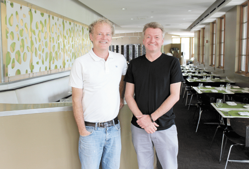 Avo and Dram Whiskey Bar owner Tom Sheffer, left, and general manager Bret Bright, right, are preparing the two adjoining Mountain Brook Village restaurants for their first year of participation in Birmingham Restaurant Week, beginning Aug. 12. Journal photo by Emily Williams.