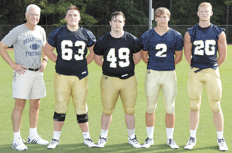 Coach Fred Yancey with, from left, Conner Hutson, Cooper Thompson, Ethan Housel and Jordan Harmon.