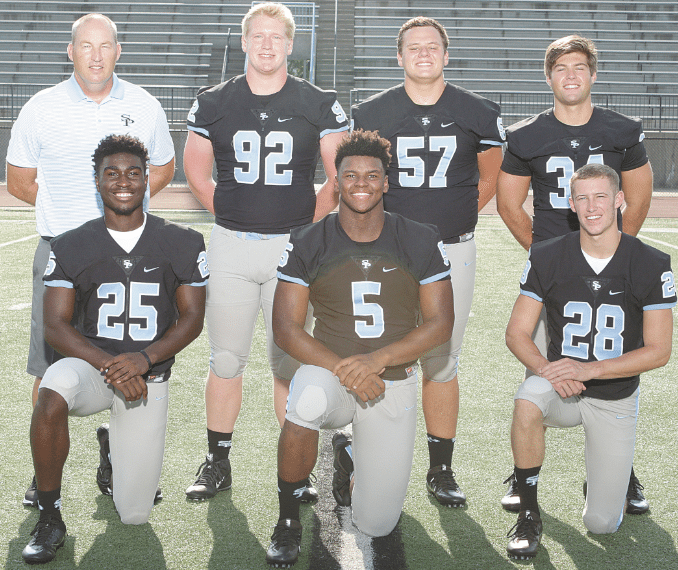 Coach Sean Raney with, front, from left: Larry Wooden, Damon Wright and Thomas Jordan. Back: Douglas Henze, Bredt Stover and Houston Hollis. Photos by Marvin Gentry.