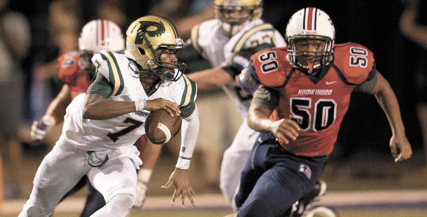 Homewood's Antoine McGhee closes in on Pelham's quarterback.