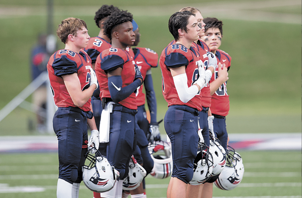 Homewood High School varsity football players pause for the National Anthem as they prepare to take on Pelham in last week's season opener. Photos by Marvin Gentry.
