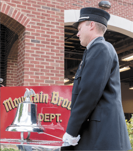 Mountain Brook Fire Department Battalion Chief Patrick Dean performs the Bell Ceremony.