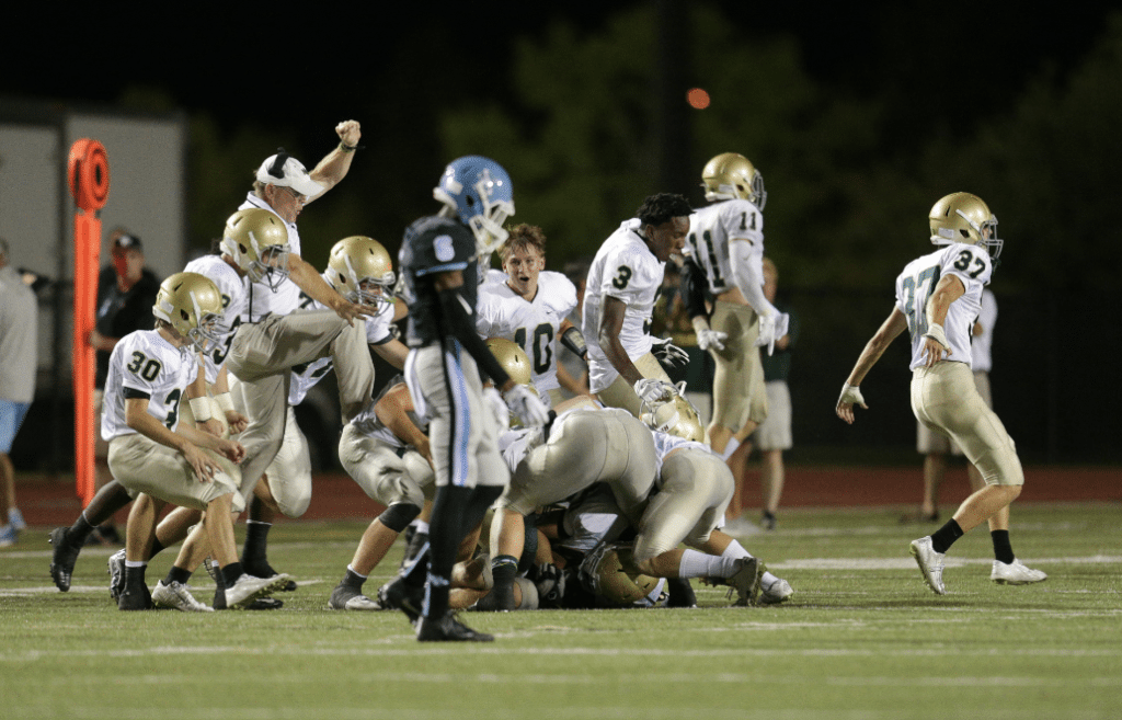 Mountain Brook players and coaches celebrate game-winning field goal by Mason Dillard to knock off Region Three rival Spain Park Friday night. Journal photo by Marvin Gentry.
