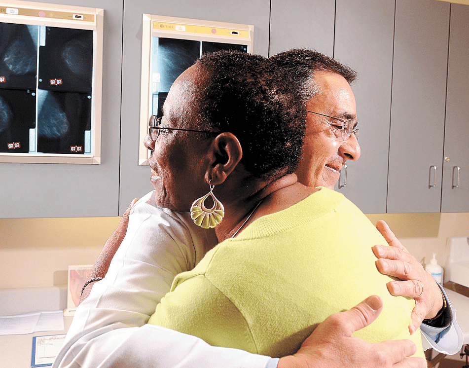 Dr. Andres Forero offers encouragement to a breast cancer patient. His work and the work of others around the world have led to a breast cancer revolution, centered on one simple finding: There are different types of breast cancer. Photo courtesy of UAB Medicine.