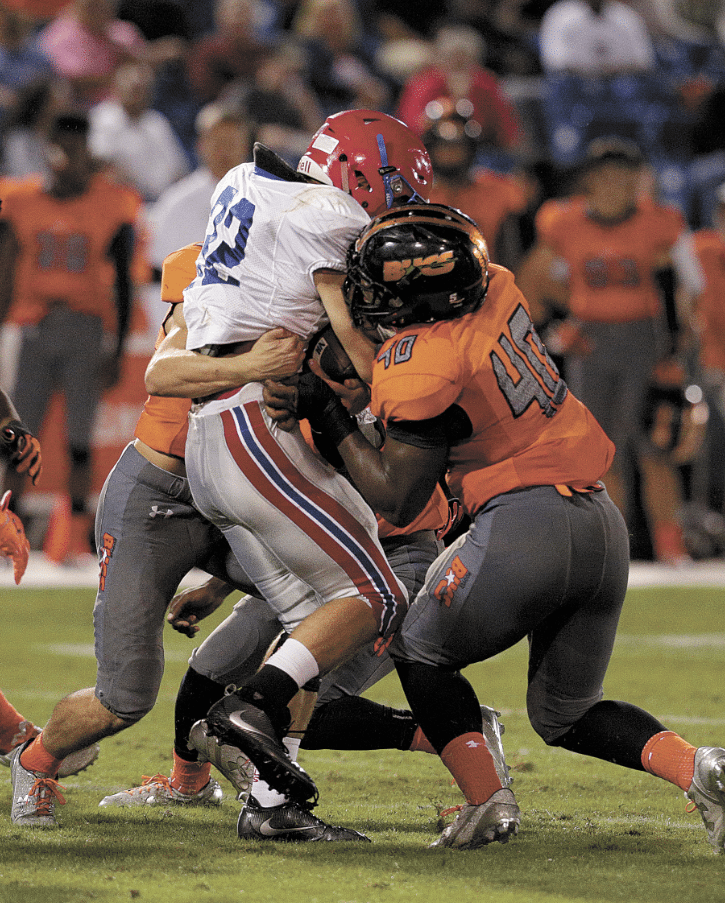 Left, Hoover held the Rebels to just 71 first half yards in their 38-7 Region 3 win.