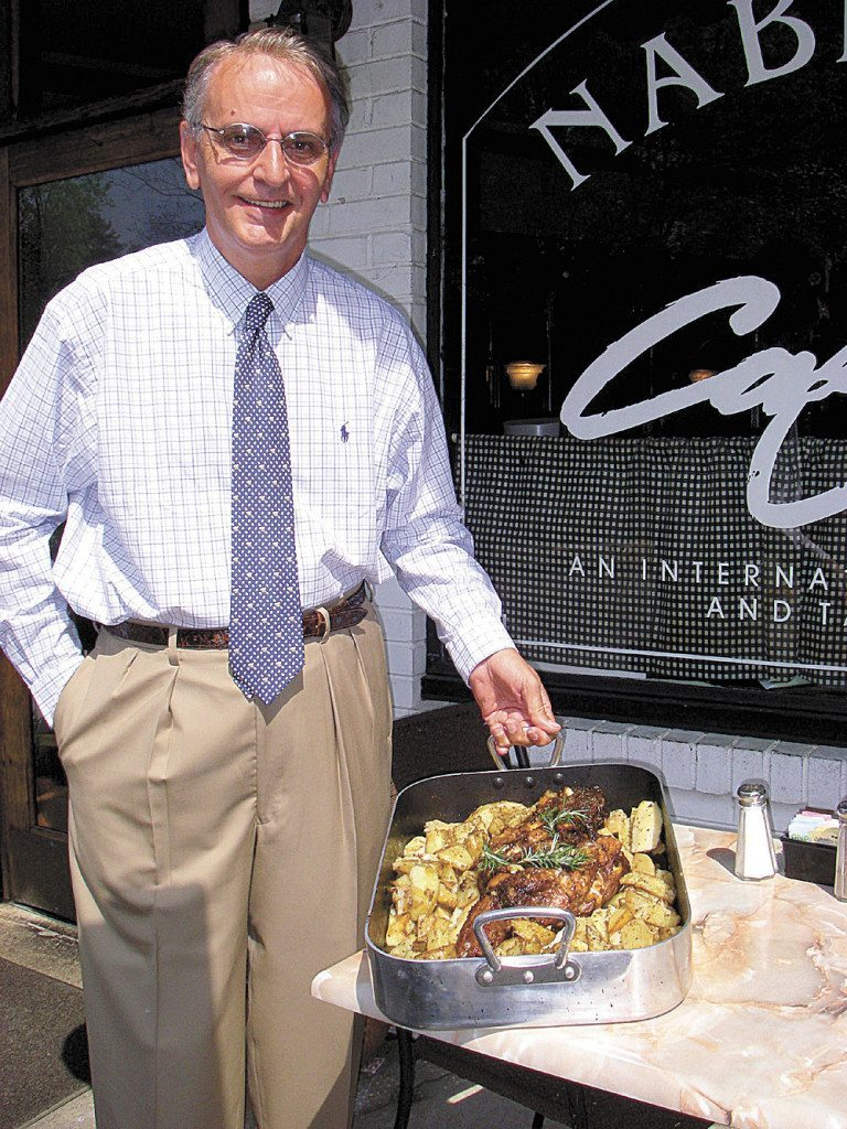 John Krontiras, general manager of Nabeel's Cafe, shows roasted leg of lamb, which his family will enjoy when they gather on Thanksgiving Day.  Photo courtesy of Nabeel's Café.