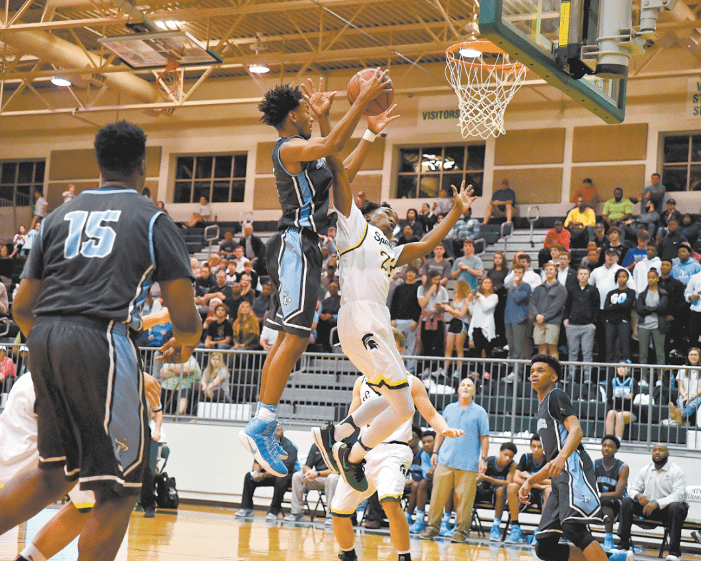 Spain Park ended Mountain Brook's amazing 38-game home winning streak last week. Jamal Johnson, left, and Sean Elmore battle for the ball in the Jags' 66-62 win over the Spartans. Photo by Lee Walls Jr.